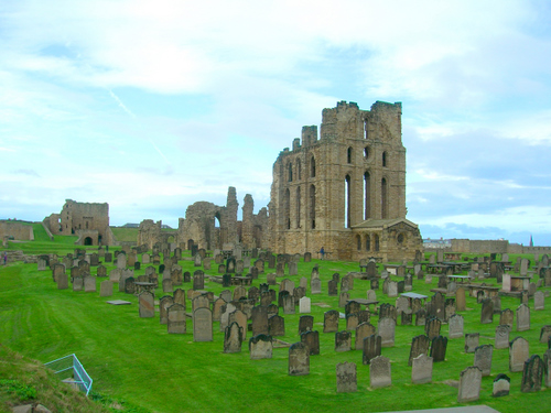 Photograph: A view of the priory church remains, looking north-west across the grave yard
