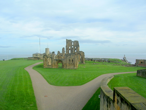 Photograph: The remains of the priory church seen from the castle gatehouse