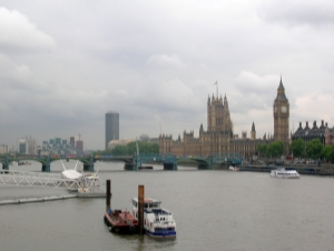 A photograph looking along the Thames at Westminster Palace on the opposite bank