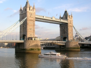 Photograph of tower bridge with a boat passing beneath