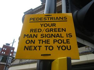 Sign on traffic signals: Your red/green man signal is on the pole next to you