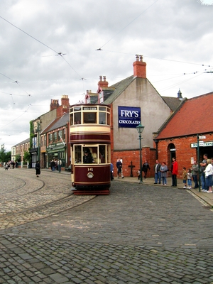 Photograph of a tram arriving in the town at Beamish