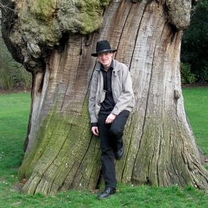 Ian Scott stood against a tree in Greenwich Park