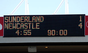 A photograph of the scoreboard showing the glorious 1-4 full time score